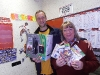 ryan-the-winner-of-the-in-shop-football-competition-with-cathy-culbert-of-mcleans